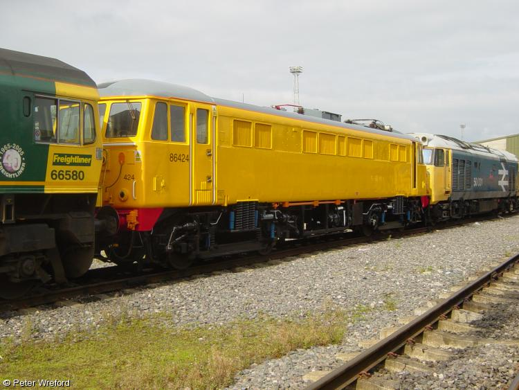 Photo of 86424 at Crewe LNWR Carriage shed